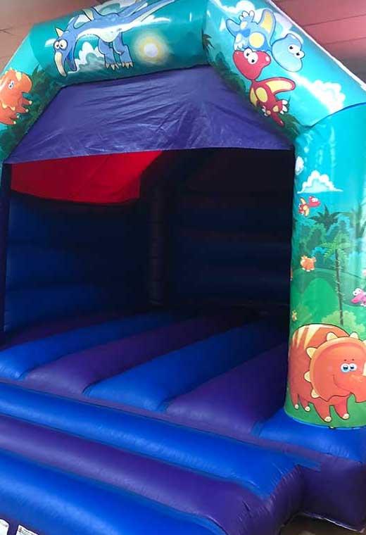 dinosaur medium bouncy castle essex rental hire